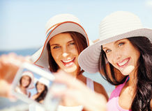 Girls taking self portrait on the beach Royalty Free Stock Image