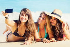 Girls Taking a Selfie at the Beach Stock Images
