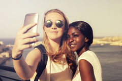 Girls taking a selfie. By the sea Stock Photos