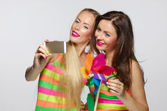 Girls taking selfie with smartphone Stock Photo
