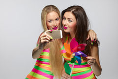 Girls taking selfie with smartphone Stock Photos
