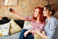 Girls taking selfie together stock photography