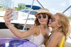 Girls are taking selfie on yacht royalty free stock images