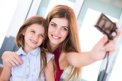 Girls taking selfies Royalty Free Stock Photos