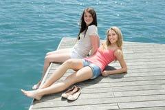 Girls taking sunbaths Stock Image