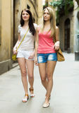 Girls taking a walk in city Royalty Free Stock Images