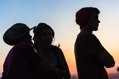 Girls Talk Boy Silhouetted Royalty Free Stock Image