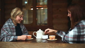 Girls talk and drink their tea porcelain teapot stock video footage