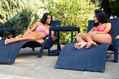 Girls talking on the deckchair Royalty Free Stock Photos