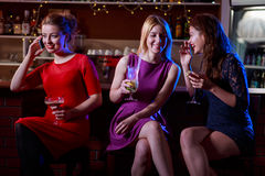 Girls talking and drinking. In the bar Royalty Free Stock Photo