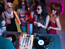 Girls talking and flirting with the dj Stock Photos