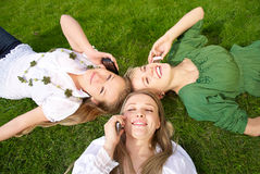 Girls talking on mobile in the park Royalty Free Stock Photography