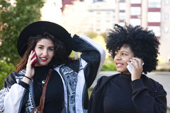 Girls talking on the mobile Stock Photography