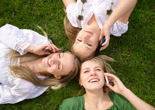 Girls talking on mobile phones Stock Photos