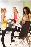 Girls talking to personal trainer at the gym Royalty Free Stock Photography