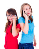 Girls talking together on mobile phone. Teen girls talking together on mobile phone stock photo