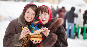 Girls  tasting pancake  during  Shrovetide Royalty Free Stock Photo