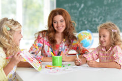 Girls  with teacher on lesson of art Royalty Free Stock Image