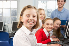 Girls and teacher in school class. Using computers Royalty Free Stock Photo