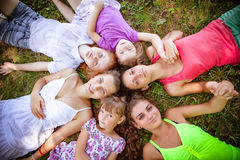 Girls teenagers in park on grass. Group of girls teenagers in park on grass Royalty Free Stock Photography
