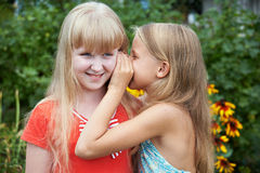 Girls tell each other secrets Royalty Free Stock Image