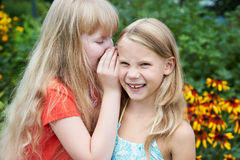 Girls tell each other secrets Royalty Free Stock Photos