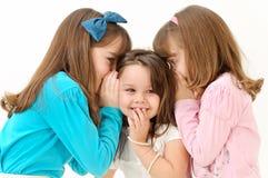 Girls telling a secret Stock Image