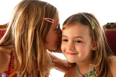 Girls telling secrets. Two young girls telling secrets Stock Photography