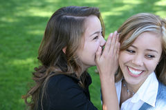 Girls Telling Secrets Royalty Free Stock Photography