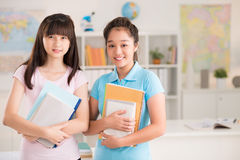 Girls with textbooks Royalty Free Stock Images