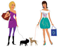 Girls with their dogs Royalty Free Stock Photography