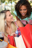 Girls with their shopping bags Stock Photos