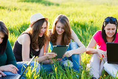 Girls With Thier Tablet Outdoors Stock Images