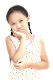 Girls think. Girls are thought to hold a pencil and thinking on white background Royalty Free Stock Image
