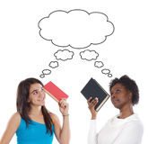 Girls thinking with books stock image
