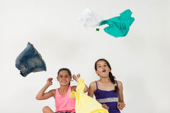 Girls throwing clothes in the air Stock Photography