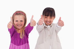 Girls with the thumbs up Stock Photography