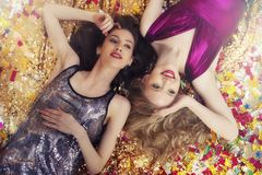 Girls tired to dance in a party. Happy tired girls to dance in a party royalty free stock photography