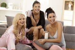 Girls watching tv at home royalty free stock image