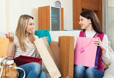 Girls together looking purchases Royalty Free Stock Image