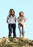 Girls on top of rock Stock Images