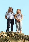 Girls on top of rock Stock Photos