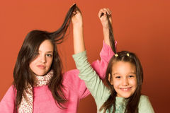Girls touching hair Stock Images