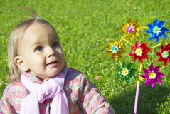 Girls with toy. Small girls with toy on the green grass royalty free stock images