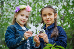 Girls with toy bunnies at spring royalty free stock photography