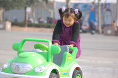 Girls and toy cars Stock Photo