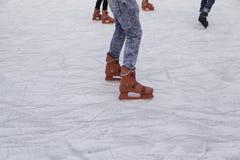 Girls track skating. Ice skating rink, fun and entertainment stock photography