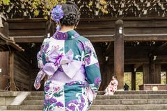 Girls in traditional clothes at the entrance to the Chion-In Temple in Kyoto, Japan. Asia Stock Photography