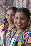 Girls on traditional costumes Stock Images