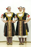 Girls in traditional costumes Stock Images